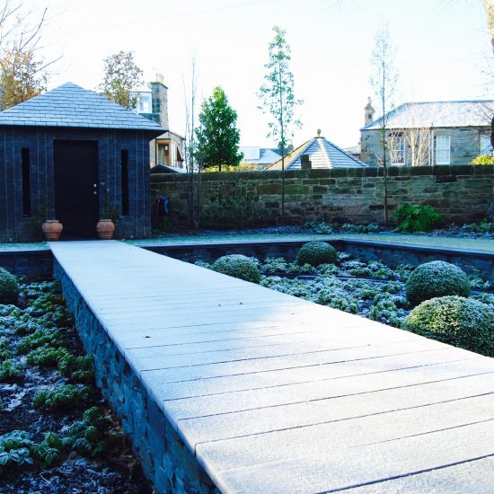 Slate garden building and boardwalk in winter, in Edinburgh garden built by Water Gems, designed by Carolyn Grohmann