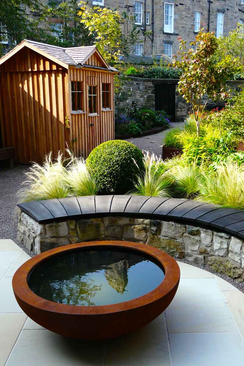 Scorched oak bench, Urbis lily bowl, Edinburgh Eton Terrace garden, built by Water Gems, designed by Carolyn Grohmann, BALI award winning 2014
