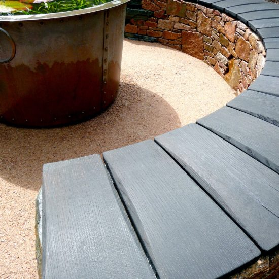 Aviemore garden, drystone bench, scorched oak seat, built by Water Gems, designed by Carolyn Grohmann, copper tub by Ratho Byres Forge